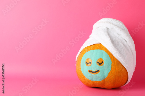 Keuken foto achterwand Spa Pumpkin with facial mask and towel on pink background, copy space