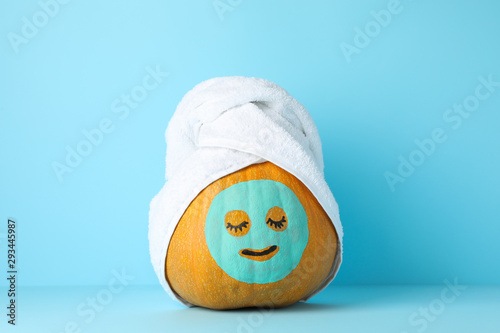 Keuken foto achterwand Spa Pumpkin with facial mask and towel on blue background, copy space