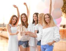 Beautiful Young Women Drinking...