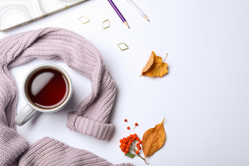 Composition with cup of hot drink on white background, top view. Cozy autumn atmosphere