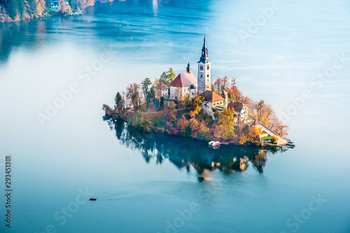 Cadres-photo bureau Automne Magical autumn landscape with boat near island on Lake Bled (Blejsko jezero), Julian Alps, Slovenia. Amazing places. Popular tourist atraction. Places of pilgrimage. (Meditation, harmony - concept)