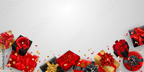 Vector illustration of red, black and golden gift boxes with ribbons, bows and shadows, and small shiny pieces of serpentine on white background