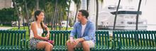 Couple Talking Sitting On City...