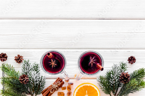 Fotografía Background with mulled wine and New Year decoration on white wooden background t
