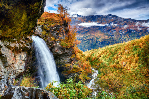 Beautifull waterfall in autumn scenery - 293461582