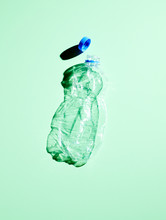 Plastic Bottle On Green Background