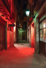 Red Illuminated Alley At Gothic Quarter, Barcelona, Spain