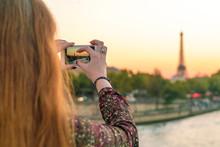 France, Paris, Woman Taking Ph...