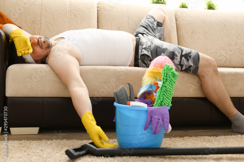 Photo  The man was left alone at home tired of cleaning and fell asleep