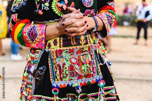 Fotografia, Obraz Detail of the colorful embroidery of a typical costume from the Andean folklore of Bolivia to dance the Tinku