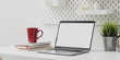 canvas print picture - Comfortable workplace with open blank screen laptop computer with red coffee cup and office supplies