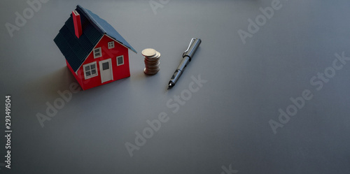 Real estate and property investment concept with small house model Wallpaper Mural