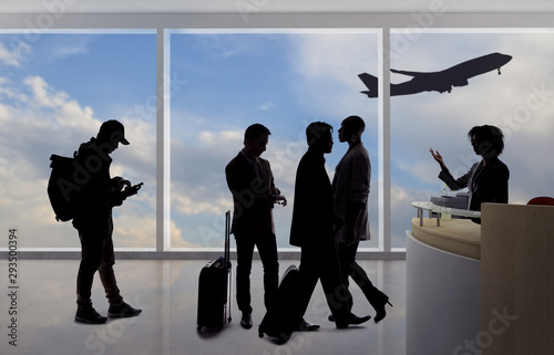 Silhouettes of passengers waiting in line at an airport check in counter with an attendant checking real ID or passport and luggage Wallpaper Mural