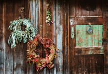 Fall Front Porch. Autumn Wreath And Pumpkins On Old Wooden Rustic Background At Doors.