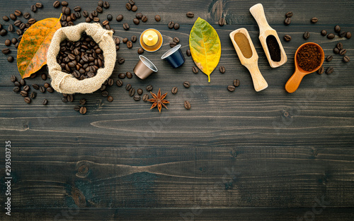 Fotobehang koffiebar Coffee beans ,coffee capsule and coffee powder on dark wooden background. Top view with copy space.