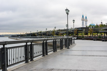 Kremlin Embankment In Kazan In Cloudy Day. The Embankment Kazanka River. Smooth Asphalt, Bicycle Lines, Roller-skate, Walking, Pedestrian Paths.