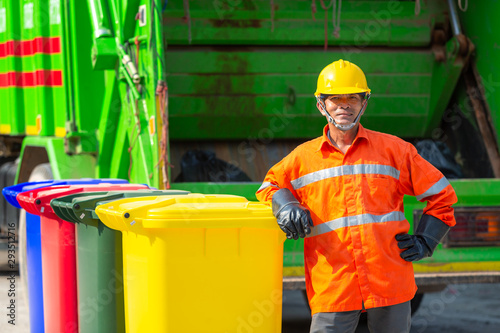 Obraz [garbage collector] Portrait of worker recycling garbage collector truck loading waste and trash bin, Trash keeper. - fototapety do salonu