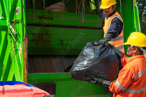 [garbage collector] Asian worker of urban municipal recycling garbage collector truck loading waste and trash bin in thailand, Trash keeper Tapéta, Fotótapéta
