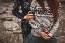 Traditional Icelandic Autumn Look. Handmade Knitted Gray And Blue Sweaters On Woman And Man Couple. Conceptual Branch Bouquet.