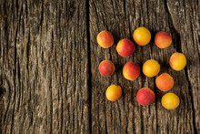 Apricots On A Dark Rustic Wooden Background. Copy Space For Text. Flat Lay