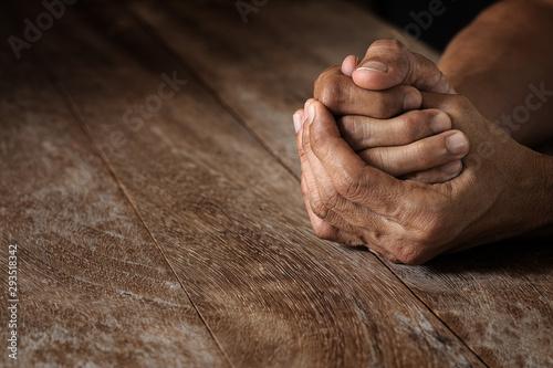 Emotional praying hand holding together on vintage grunge wooden table selective Fototapeta