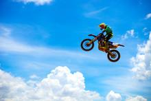 Motocross Rider Jump In A Blue...