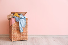 Basket With Laundry On Floor N...