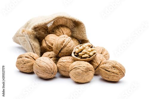 Obraz pile of walnuts in juta bag on white background - fototapety do salonu