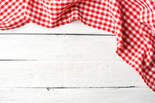 Red Checkered Tablecloth On Wh...