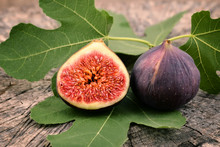 Fresh Figs On Old Wooden Backg...