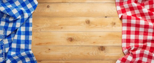 cloth napkin at rustic wooden background, top view Fototapeta