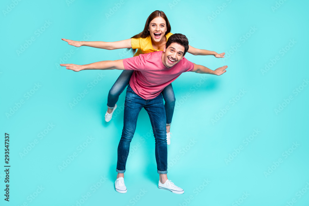 Fototapety, obrazy: Full length body size view of nice attractive playful funny cheerful cheery couple guy carrying girl having fun like flying isolated over bright vivid shine vibrant green turquoise background