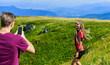 Young adventurers. Couple taking photo. Couple in love hiking mountains. Lets take photo. Capturing beauty. Man and woman posing mobile photo. Summer vacation concept. Travel together with darling