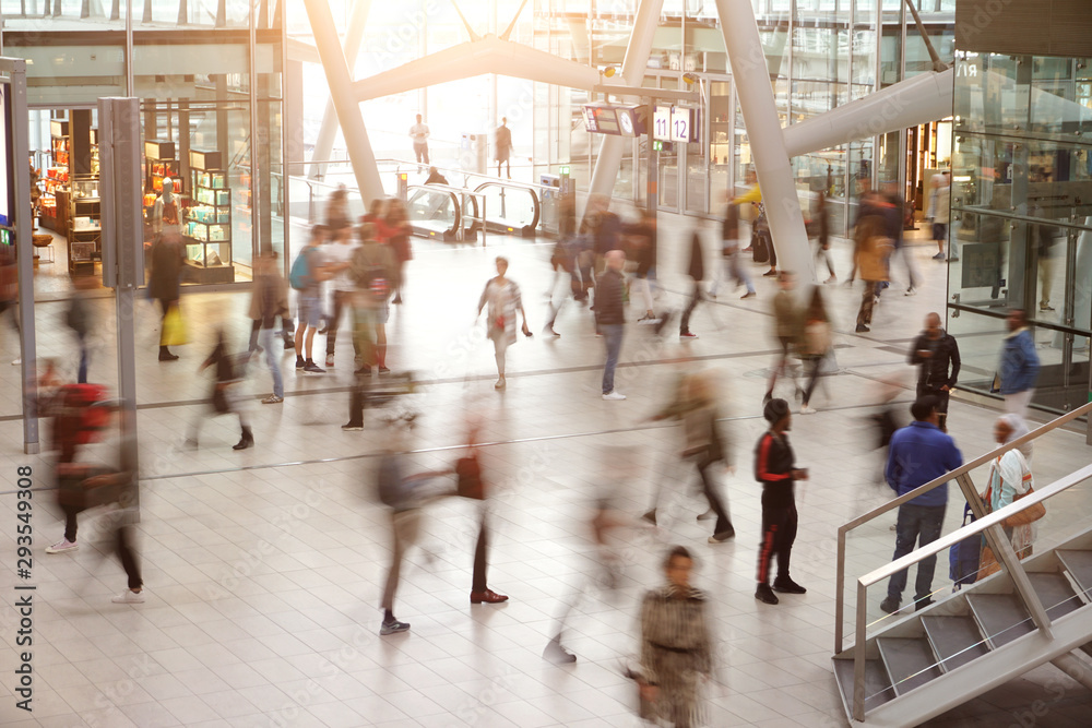 Fototapeta Blurred travelers in motion in Utrecht Central Station, Netherlands