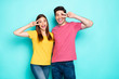 canvas print picture - Portrait of his he her she nice attractive lovely funny cheerful cheery couple hugging showing v-sign near eye lifestyle isolated over bright vivid shine vibrant green turquoise background