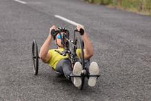 Man Cycling On Recumbent Bicycle