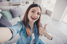 Close Up Photo Of Positive Cheerful Girl Have Free Time On Vacation Take Selfie Show Thumb Up Advise Excellent Resort Hotel Wear Denim Jeans Clothes Indoors In Room