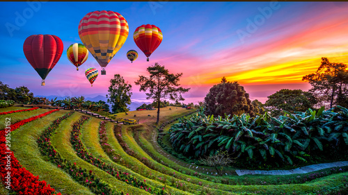 Colorful hot air balloons flying over mountains and mist in sunrise time, Huai Nam Dang National park in sunrise, Chiang Mai Province, Thailand..