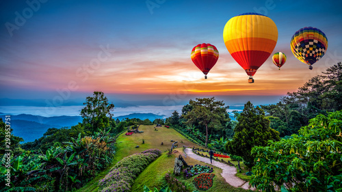 Foto auf Leinwand Ballon Hot air balloons adventure in nature over winter mountain in Chiang Mai, Thailand.