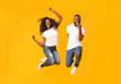 canvas print picture - Joyful black couple jumping up and down