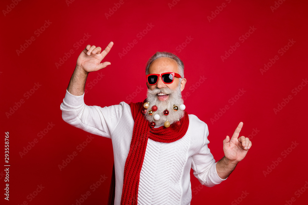 Fototapeta Portrait of cheerful pensioner with eyewear eyeglasses dancing wearing white pullover isolated over red background