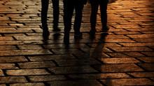 Dark Silhouettes Of Three Peop...