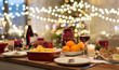 canvas print picture - christmas dinner and eating concept - food and drinks on table at home