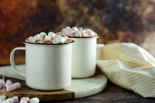 Foto auf Leinwand Schokolade Two cups of hot chocolate, cocoa or warm drink with marshmallows on dark background