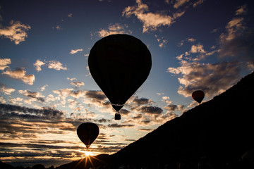hot air balloons flying at sunset - live your dream, freedom and adrenaline concept