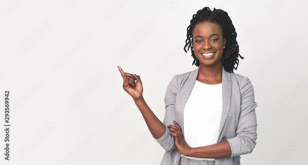 Fototapeta Black Business Lady Pointing Finger At Empty Space On White