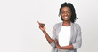 Black Business Lady Pointing Finger At Empty Space On White