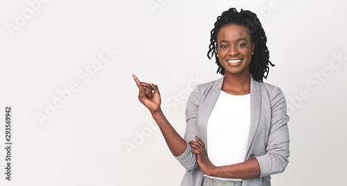 Fotografie, Obraz  Black Business Lady Pointing Finger At Empty Space On White
