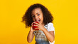 canvas print picture - Vitamin snack. Little girl biting red apple