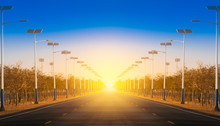 Solar Street Light Lamp Post Led With Panel System On The Road With Blue Sky And Beautiful Sunset Using For Background Energy Saving Concept.